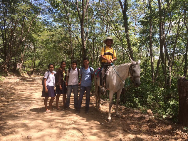 Teacher and pupils riding a horse in El Lagartillo, Nicaragua